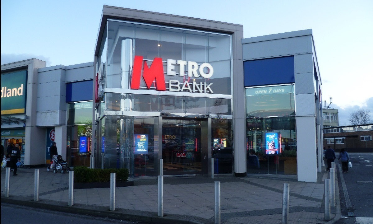 Metro Bank sees profits halve and big customers leave after accounting error